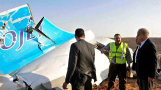 Egyptian Prime Minister Sherif Ismail (right) views the wreckage after the crash (file photo)