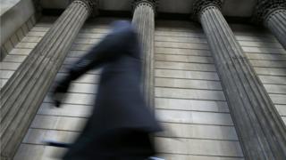 Man walking through City of London