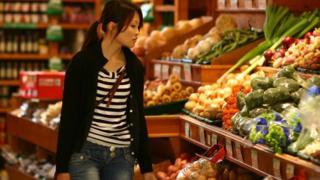 Woman shopping in Scotland supermarket