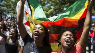 Zimbabweans celebrate after President Robert Mugabe resigns for Harare on November 21, 2017