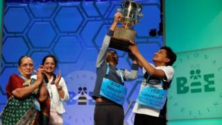 Co-champions Nihar Saireddy Janga (L) and Jairam Jagadeesh Hathwar (R) hold their trophy upon completion of the final round at the 89th annual Scripps National Spelling Bee at National Harbor in Maryland U.S. May 26, 2016