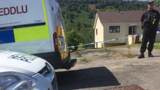 Police officers have put a cordon around the house
