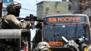 Soldiers of the Brazilian Army patrol a street of the favela Rocinha, in Rio de Janeiro, Brazil, 10 October 2017.