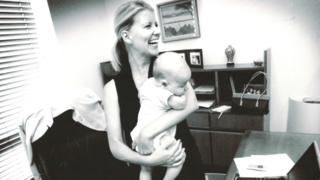Natasha Stott Despoja holds her baby in her parliamentary office