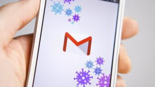 A smartphone showing the Gmail logo
