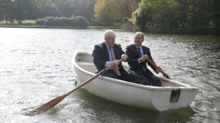 "Boris Johnson (left) in a row boat with Czech Republic""s Deputy Foreign Minister Ivo Sramek"