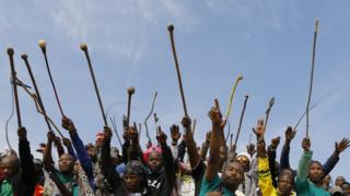 South African miners in Marikana dance, sing and wave sticks - Tuesday 16 August 2016