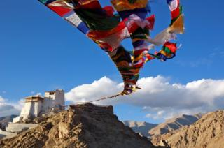 Prayer flags fly at Namgyal Tsemo Monastery above the town of Leh in Ladakh, India.