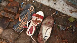 Shoes and belongings of victims are collected as evidence at St Sebastian's Church in Negombo