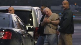 Former Panamanian President Ricardo Martinelli is escorted by US marshals to an awaiting jet early morning June 11, 2018 at Opa Locka airport near Miami