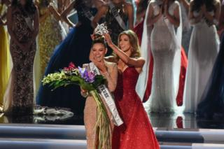 Miss South Africa 2017 Demi-Leigh Nel-Peters (L) reacts as she is crowned new Miss Universe 2017 by Miss Universe 2016 Iris Mittenaere November 26, 2017 in Las Vegas, Nevada Beauties from across the globe converged in Las Vegas Sunday, where Miss South Africa was crowned Miss Universe. Demi-Leigh Nel-Peters, 22, edged out her rivals from Colombia and Jamaica to take the crown. Nel-Peters, a graduate in business management, said her disabled half-sister has been among her great inspirations.