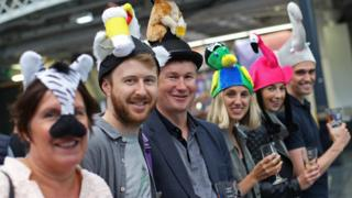 Friends pose during the traditional hat day during the CAMRA Great British Beer Festival at Olympia in London