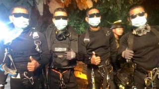 The last four Thai Navy SEALs giving a thumbs up after exiting safely from the Tham Luang cave in Khun Nam Nang Non Forest Park in Mae Sai district,