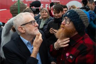 A man compares his beard with Jeremy Corbyn