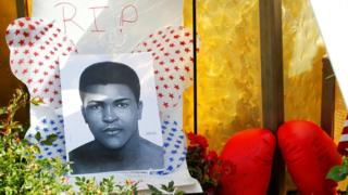 Fans of Muhammad Ali leave pictures and personal mementos as they pay their respects at the Ali Center in Louisville on 6 June