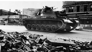 A tank patrols a Detroit street on 25 July 1967