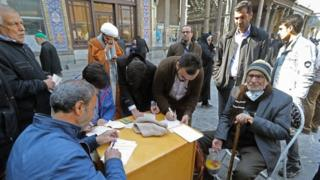 Donald Trump Residents of Tehran casts their votes in Friday's election
