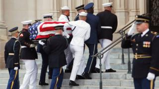 An honour guard carries the coffin of the late Senator John McCain into the Washington National Cathedral, September 1, 2018