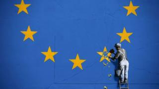 Banksy Brexit artwork of workman chipping away at the EU flag, Dover, 8 May 2017