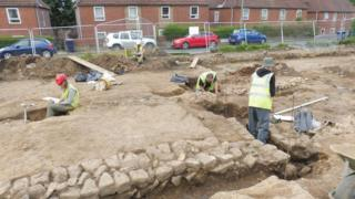 Workmen at the site of the Roman remains in Benwell