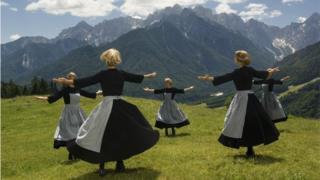 Women dressed as Maria dance on the Austrain mountain