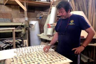 Lampedusa carpenter Francesco Tuccio with some of the crosses