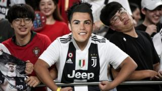 South Korean fans wear Ronaldo masks