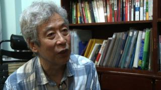 Screen grab taken from AFP video footage shows former professor Sun Wenguang talking in his home in Jinan, 2013