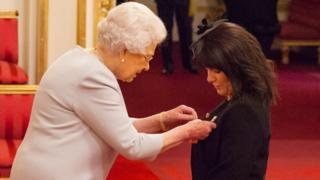 Jayne Senior receiving her MBE medal from the Queen at a Buckingham Palace investiture ceremony on 8 November 2016