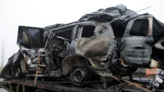 The damaged vehicle that drove over a mine while transporting members of the Organization for Security and Cooperation in Europe (OSCE), who were killed and injured from the incident on Sunday, is moved from the scene in Luhansk region, Ukraine, April 23, 2017.