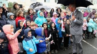 A crowd greets Prince Charles as he visits Llandovery Hospital to unveil a new x-ray machine