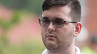 """James Alex Fields Jr is seen attending the """"Unite the Right"""" rally in Emancipation Park before being arrested by police on 12 August, 2017"""