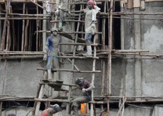 Men work in a construction site in Goma, the capital of North Kivu, eastern Democratic Republic of Congo, April 4, 2018