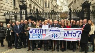 Heads in Worth Less campaign