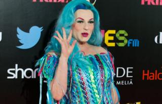Spanish singer Amapola Lopez - known as 'La Prohibida' - waves for the cameras in a blue dress that matches her blue hair