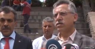 Kazim Arslan speaking to reporters in the square