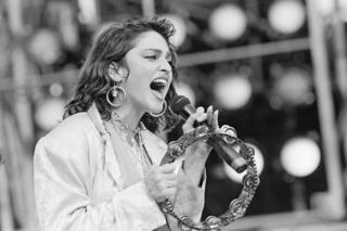 Madonna sings during the U.S. Live Aid concert held to raise money for famine victims in Ethiopia at the John F. Kennedy Stadium in Philadelphia