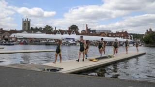 Rowers carrying boat