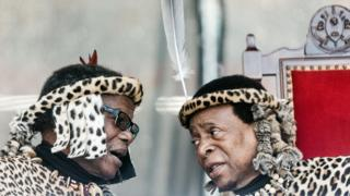 Inkatha Freedom Party ( IFP) leader Prince Mangosuthu Buthelezi (L) and Zulu King Goodwill Zwelithini (R) chat at The Moses Mabhida Football Stadium in Durban on 7 October 2018.