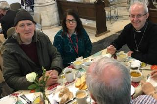 The Archbishop of Canterbury sat down to eat with some staff and users of the church