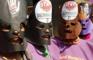 Garment workers wear masks during a rally in Dhaka, Bangladesh
