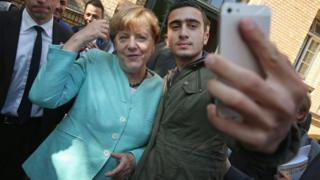 Mr Modamani in a selfie with Angela Merkel