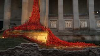 Poppies drape down St George's Hall