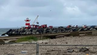 Rescue equipment parked on Scheveningen pier to recover the fifth body