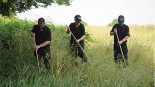 Police searching a field in Connah's Quay