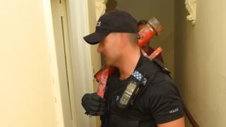 Police officer with enforcer