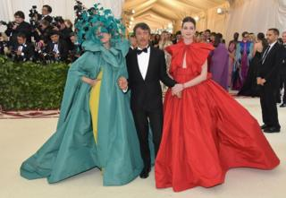 Actress Frances McDormand (L), Valentino designer Pierpaolo Piccioli (C) and actress Anne Hathaway (R) appear together on the red carpet.