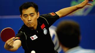 Kong Linghui of China returns a shot during the men's doubles final of the 48th World Table Tennis Championships against Timo Boll and Christian Suss of Germany at Shanghai Gymnasium on May 5, 2005 in Shanghai, China