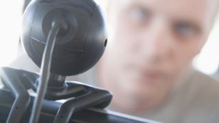 Man in front of webcam