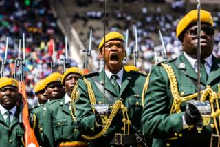 Members of Zimbabwe's guard of honour parade during the country's 37th Independence Day celebrations Tuesday. / AFP PHOTO / 18 April 2017